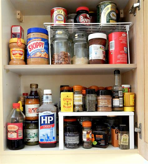 cupboard shelf ideas kitchen storage solutions cupboard organizer raised