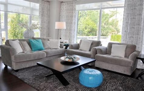 moroccan pouf and turquoise accents shine in a gray living