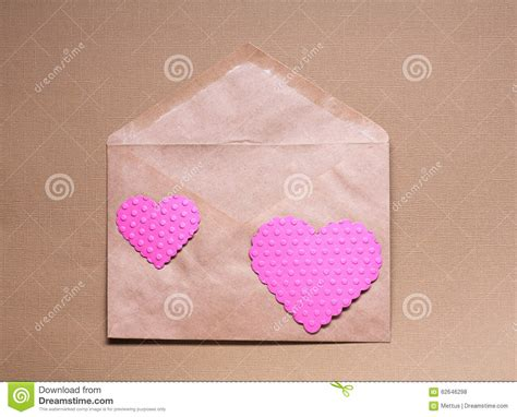 Pink Craft Paper - two pink hearts on craft paper envelop stock photo image