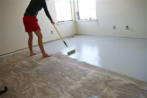 epoxy over plywood subfloor diy stencil painted subflooring home diy wood floors diy flooring painted plywood