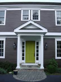 grey siding and green door entryway ideas