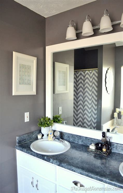how to put up a bathroom mirror how to frame out that builder basic bathroom mirror for 20 or less