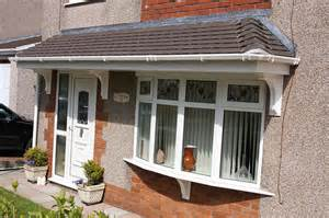 bow window canopies bow bay window with door and slate canopy flickr photo