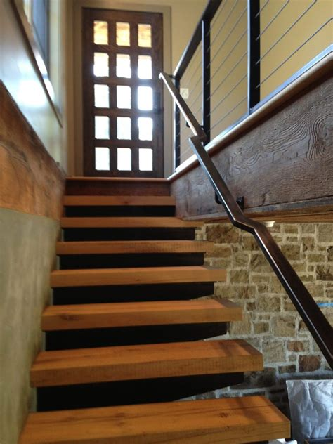 10 standout stair railings and why they work steel vs wood staircase 3 story steel margerie olivier