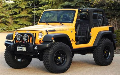 yellow 2 door lifted rubicon jeep wrangler no top with a