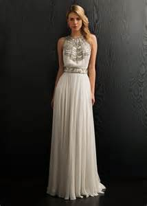 Neckline dress with beaded bodice and waist band made from 100