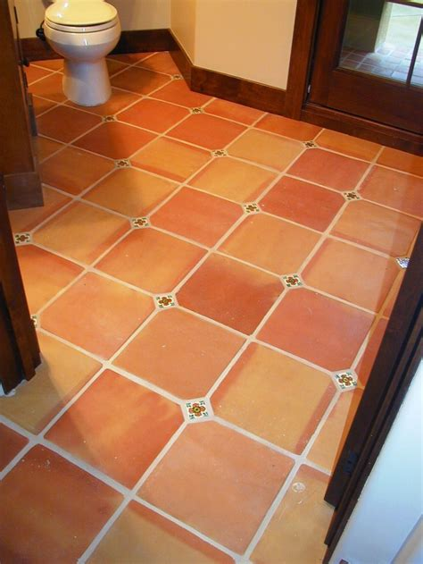 floor in spanish saltillo tile with painted tile inserted as needed these
