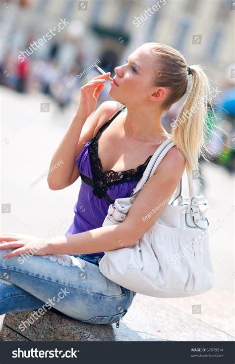 young girl smoking cigarette stock photos images woman smoking cigarette on street stock photo 57870514