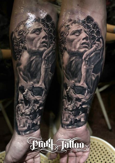 angel statue tattoo stonework style marvelous looking forearm of human