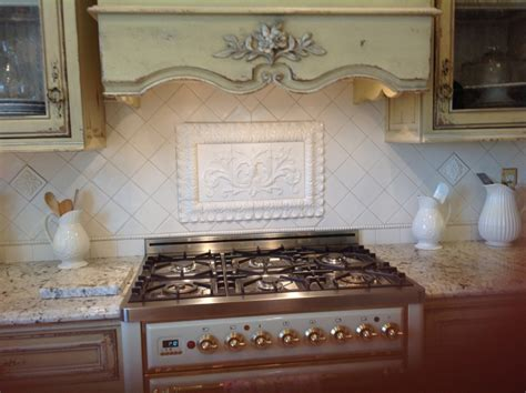 Pic Of Kitchen Backsplash hand pressed floral tiles installed in kitchen backsplash