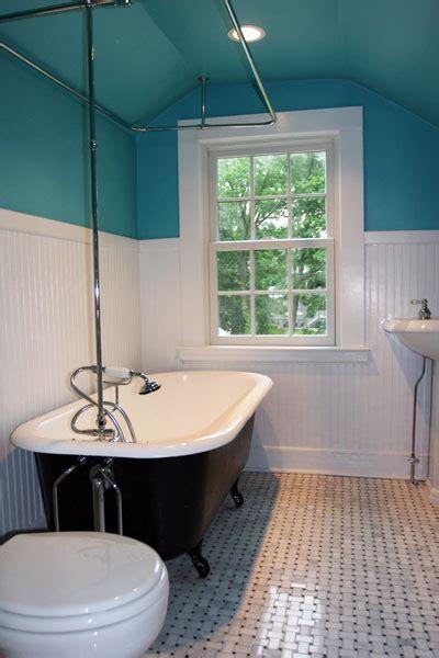 bathroom  clawfoot tub  glass tile xcelrenovation