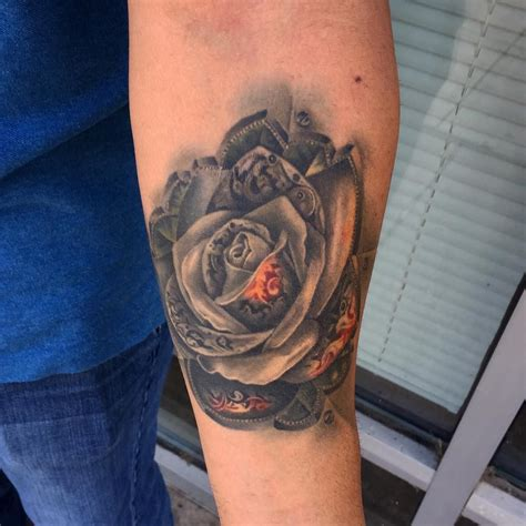 steel rose tattoo healed metal i did last year on a cool client