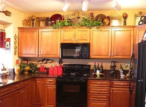 decorating ideas for the top of kitchen cabinets pictures wine themed kitchen paint ideas decolover net