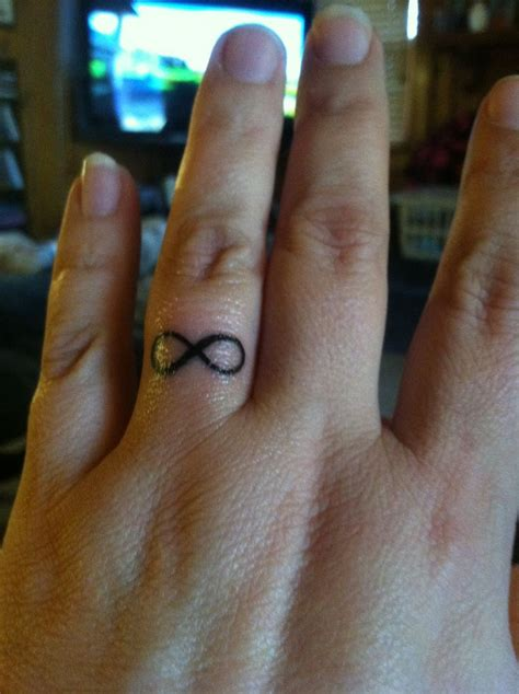 infinity tattoo on finger meaning infinity tattoo on my ring finger tattoos baby pinterest