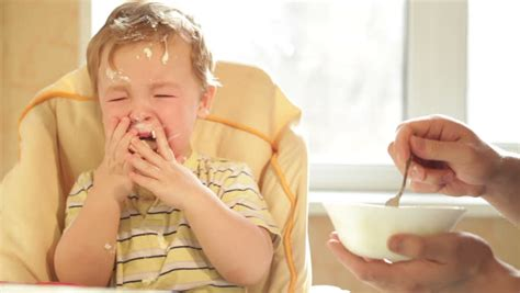 doesn t want to eat boy is because he doesn t want to eat more cereal stock footage