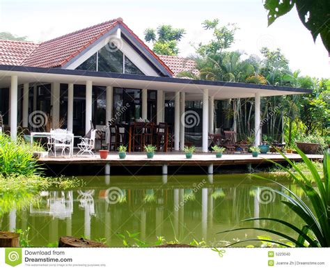 House Plans With Front Porch One Story tropical house veranda amp natural pond stock photo image