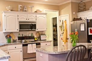 tips decorating above kitchen cabinets my kitchen how to decorate above kitchen cabinets from thrifty decor