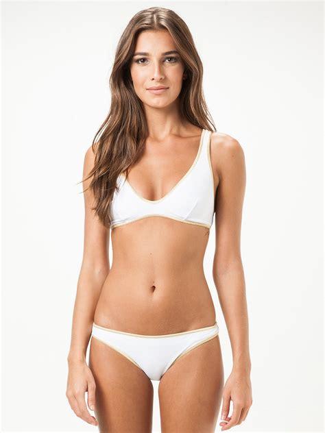 white sports bra style bikini with gold coloured edging   louisiana