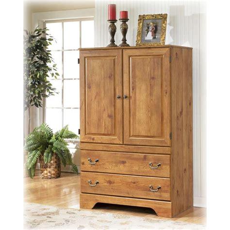 ashley furniture armoire b219 49 ashley furniture armoire replicated pine grain