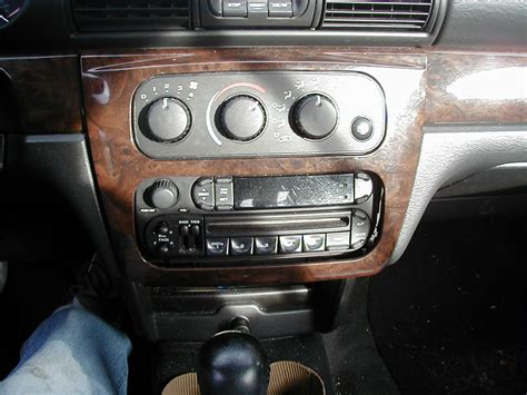 all car manuals free 2009 chrysler sebring instrument cluster how do i remove the factory stereo from my 2004 sebring