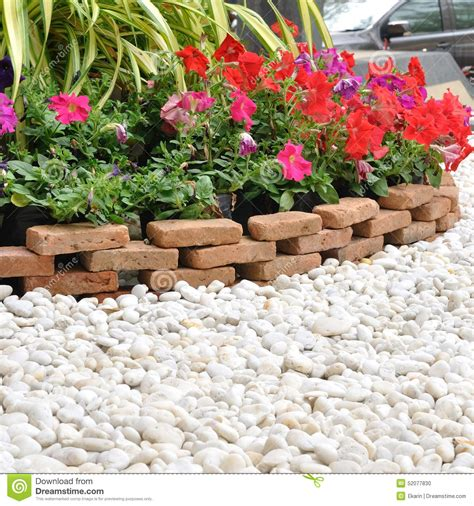 Garden Decoration Business by Garden Decoration With White Rock And Flowers Stock Photo