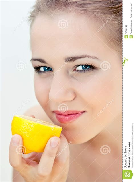 eats lemon beautiful eats a lemon royalty free stock images image 21568749