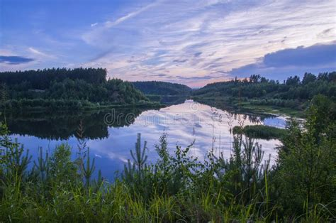 green water gray skies books lake forest reflection stock image image 103260233