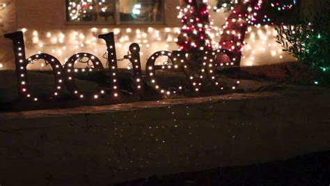 christmas twinkling holiday light up sign believe stock