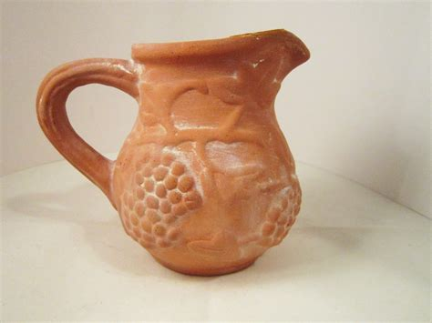 molded grapes and vine terra cotta clay pottery pitcher