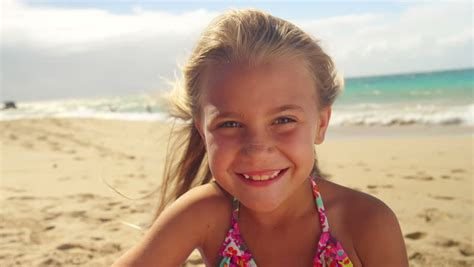 youngmodelsclub net young models a cute little girl in her bathing suit dances on the beach