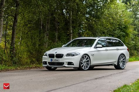 White Series white bmw 5 series touring puts on 22 quot wheels carscoops