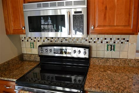 kitchen tile designs behind stove tiled kitchen backsplash below and behind the microwave