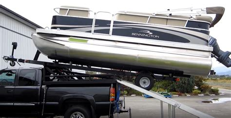 pontoon boat on car trailer how to load a pontoon boat on top of your truck video