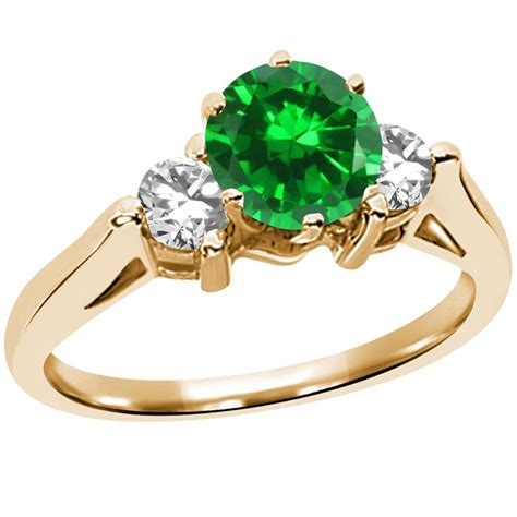 gold emerald engagement rings for