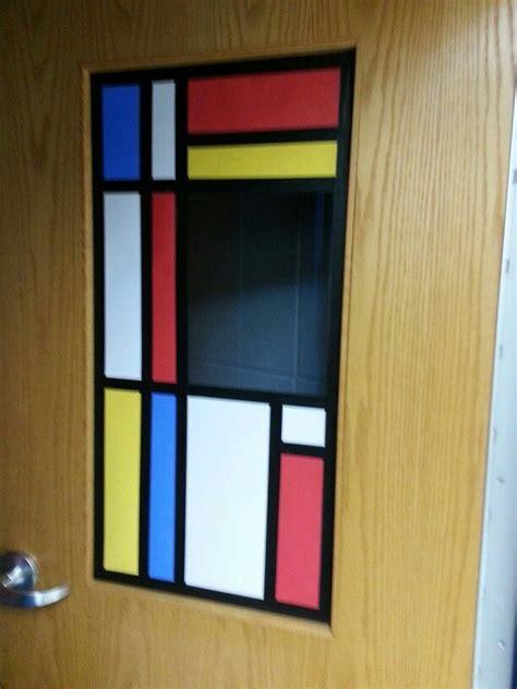 glass door student painters classroom door ala mondrian education