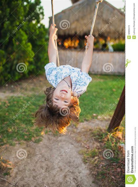 head swinging boy swinging on a swing stock photos image 32800473