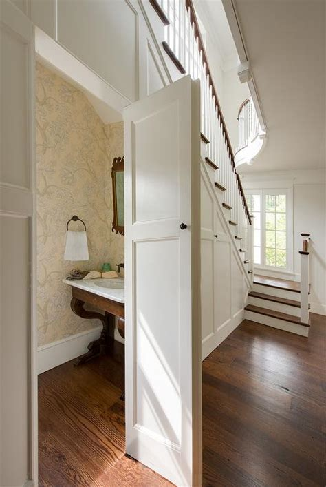 concealed powder room   stairs transitional