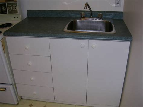 kitchen cabinets with sink manicinthecity