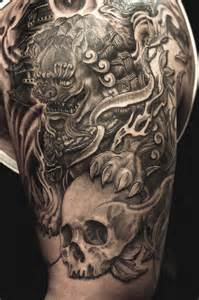 foo dog tattoo design half sleeve black and grey foo and skull jpg