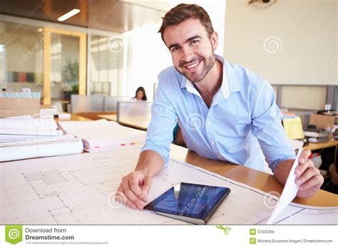 architect online male architect with digital tablet studying plans in