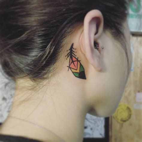small feather tattoo behind ear feather ear colorful feather tattoos
