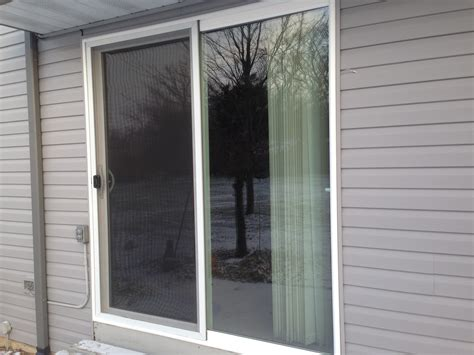 exterior white vinyl screen sliding door with pet door