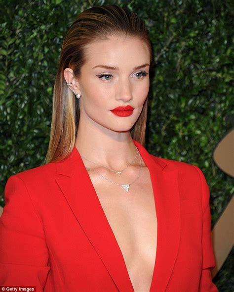 womans face at angle hair slicked on white stock photo 2013 british fashion awards rosie huntington whiteley