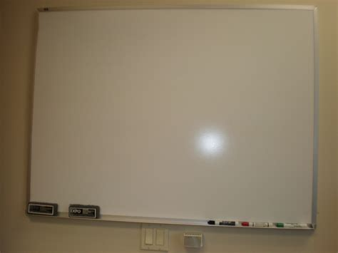 big white boards what is the right word to refer to a