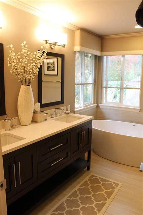 warm toned bathroom  furniture style vanity visit
