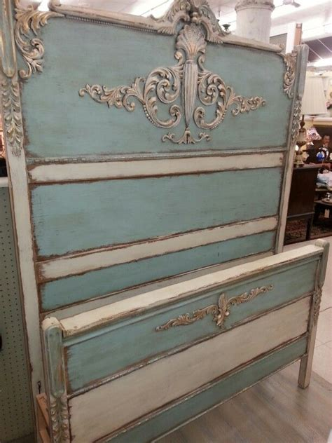 antique bed painted with blue and linen farmhouse paint next tea stain antiquing