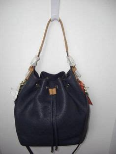 Dooney Bourke The Fray Band Members With Their Dooney Bags by Vintage Coach Hobo Handbag Denim And Leather By Ladolfina