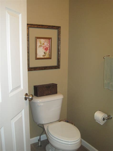 how to add a bathroom designed to dwell adding storage in a tiny bathroom