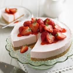 strawberry cheesecake with strawberry sauce woman and home