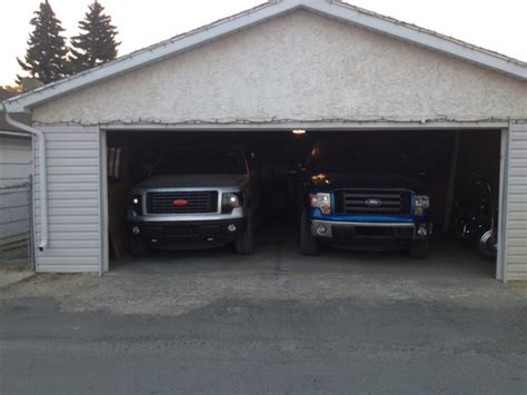 how big is a 2 car garage can you fit your big ford and another car comfortably into